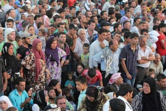 Syyrialaisia pakolaisia virtaa Irakin kurdialueille. Kuva: UNHCR / G. Gubaeva